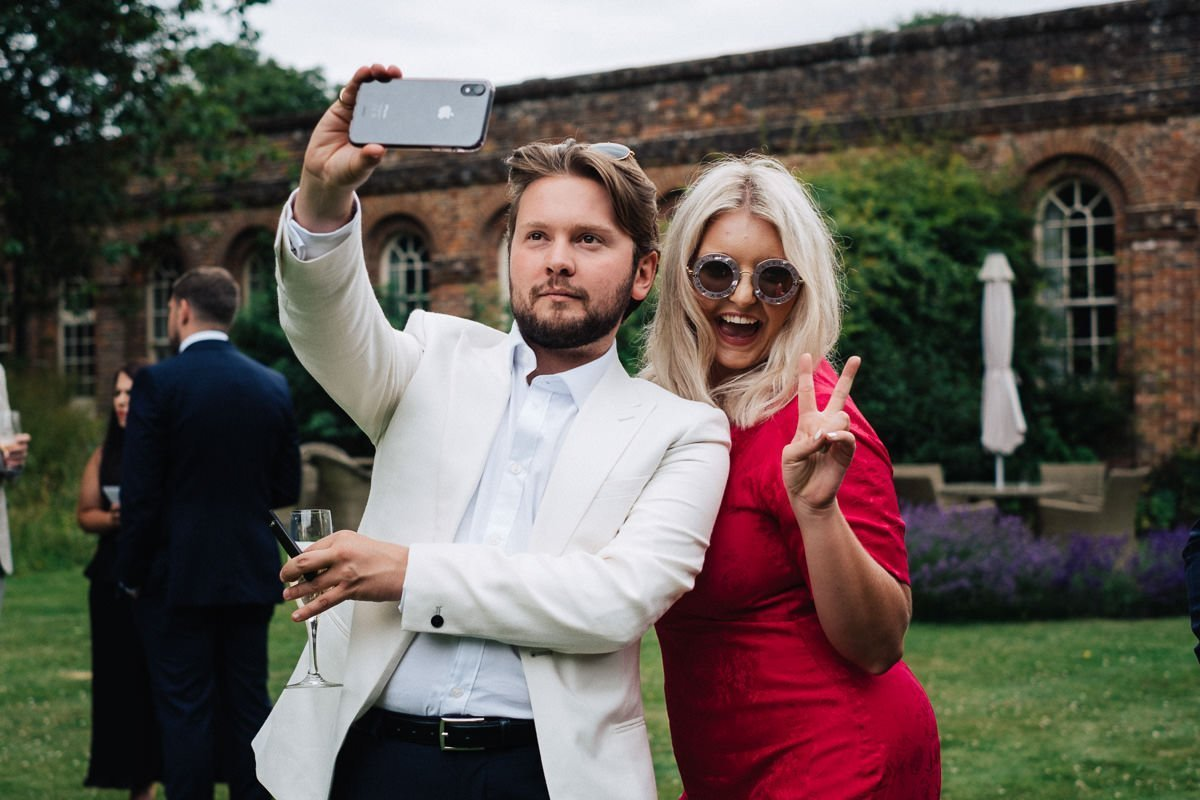 Candid fun photo of guests at wedding