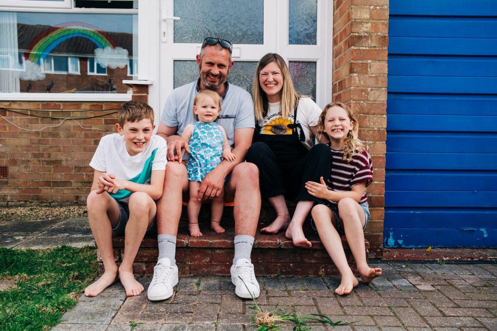 Bellman Family sitting on doorstep photo