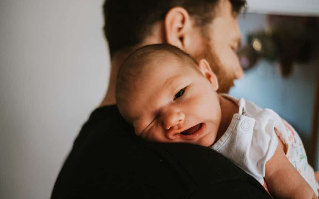Gorgeous baby photo on dad's shoulder
