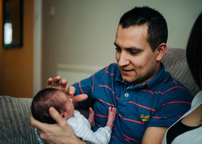 Dad touching newborn's nose